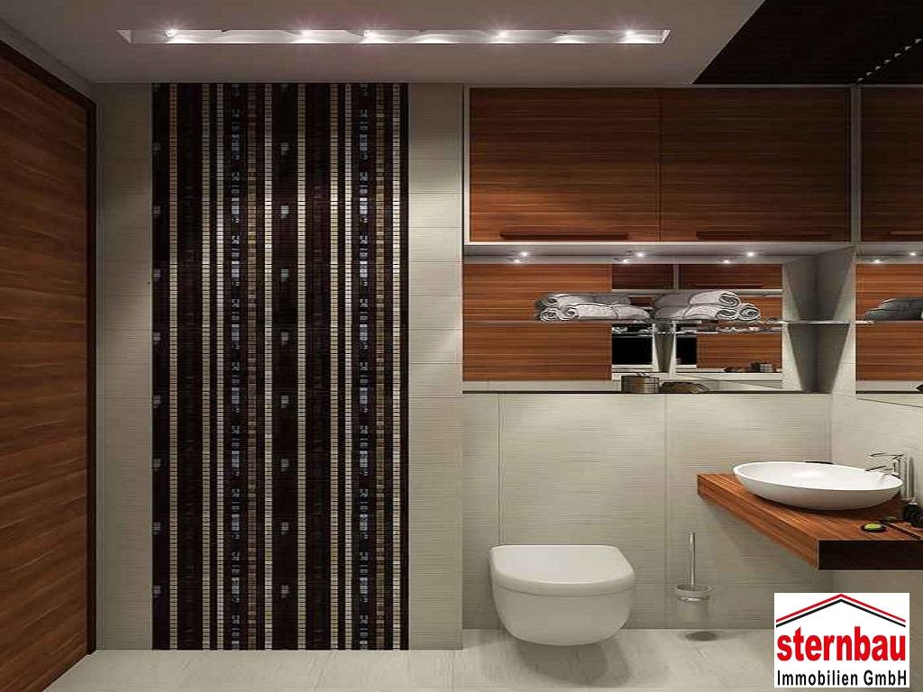 Ihr Fachbetrieb für Badsanierung Die beste Ideen mit uns finden: für ihr Traumbad in die Zukunft blicken Die Badsanierung sowie des Gäste WC ist eine hochpreisige Angelegenheit. Nehmen Sie sich daher viel Zeit und lassen Sie sich beraten, bevor Sie viel Geld für die Badsanierung ausgeben. Sie brauchen keine guten, sondern die beste Lösungen für Ihr zukünftiges Traumbadezimmer, anschließend müssen Sie viele Jahre mit ihm leben. Da wir in Ihrem Bad die Vorteile einer schönen, ansprechenden Gestaltung mit unseren eigenen Architekten, neuster Technik und qualitativ hochwertiger Materialien vereinen möchten, ist eine sorgfältige Planung von großer Bedeutung. Zudem können wir mit einer Umstrukturierung der Raumaufteilung ungeahnte Möglichkeiten entdecken, die sich selbst in einem kleinen, schmalen Bad verstecken. Kreative Lösungen, moderne Formen und ein stimmiges Farb- und Lichtkonzept lassen den Raum freundlicher und größer erscheinen und verbreiten eine entspannende Wellnessatmosphäre. Ganz egal, ob Gästebad, Wellnessbad, barrierefreies Bad oder Home-Spa, wir machen Ihre Wünsche wahr. Das Einzige, was Sie tun müssen ist, uns Ihre Wünsche und Vorstellungen mitzuteilen, sodass wir ein stimmiges Badkonzept nach Ihrem Geschmack entwickeln können. Selbstverständlich ist nicht immer eine Komplettsanierung Ihres Bades notwendig. Gerne bringen wir mit einer Teilsanierung etwas frischen Wind in Ihre vier Wände und verhelfen Ihrem Bad durch schöne Mosaikakzente, neue Fliesen, einen schönen Waschtisch oder neuen, glänzenden Armaturen zu einem neuen Look.